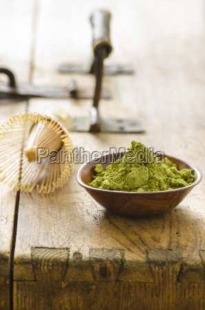 bowl with matcha powder and a