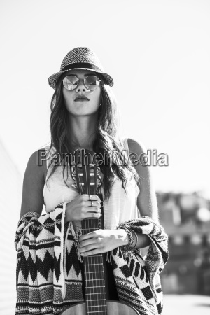 young woman wearing boho style holding