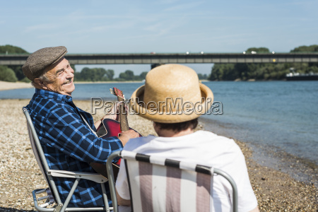 germany ludwigshafen senior couple with guitar