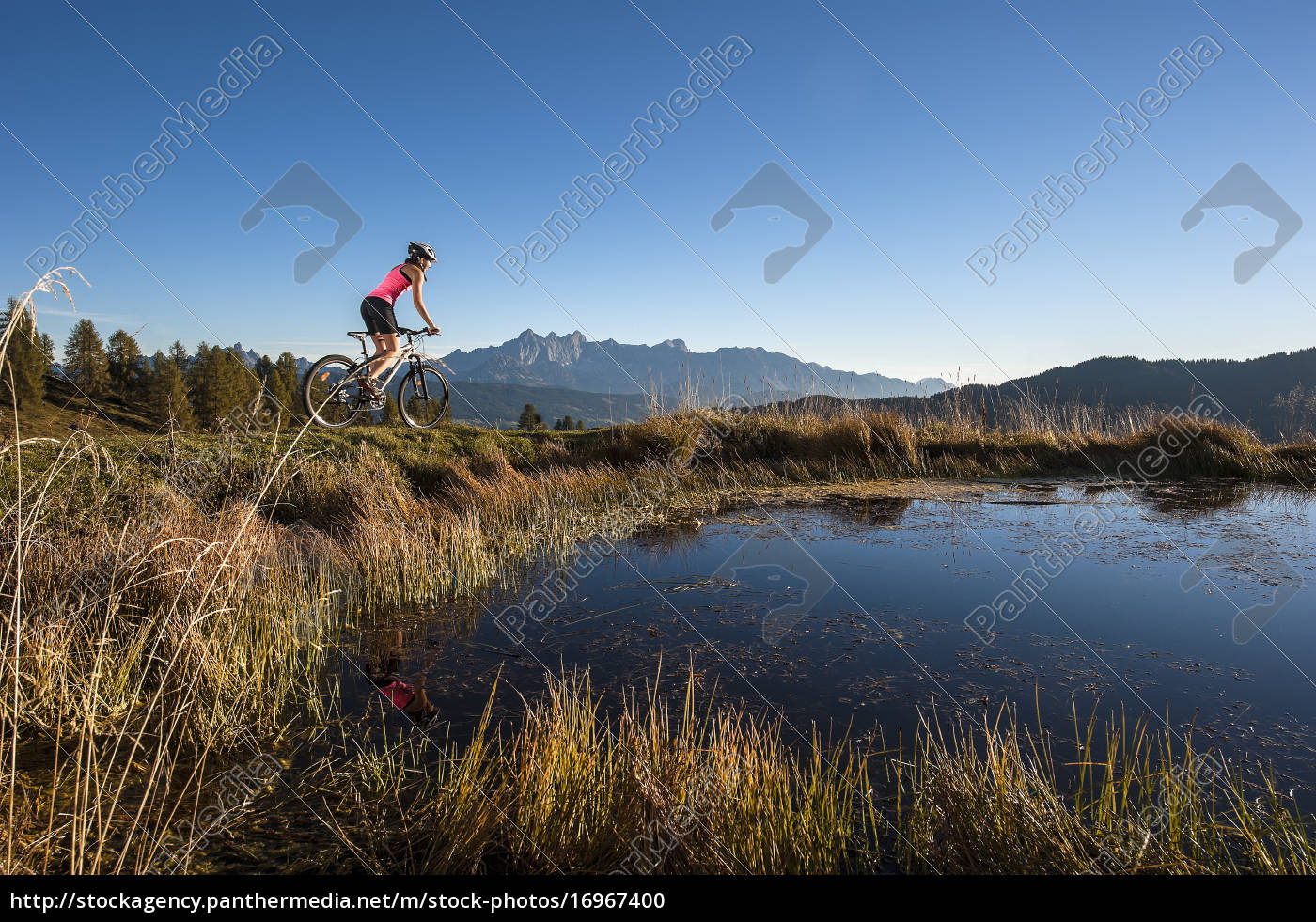 austria, , altenmarkt-zauchensee, , young, woman, riding, mountain - 16967400