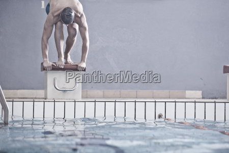 swimmer in indoor pool in starting