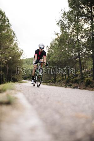 cyclist riding a bike on a