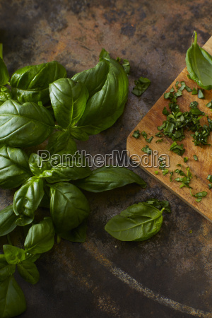 whole and chopped basil leaves