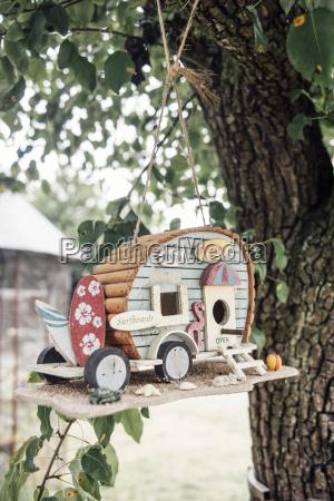 caravan bird houses hanging in a