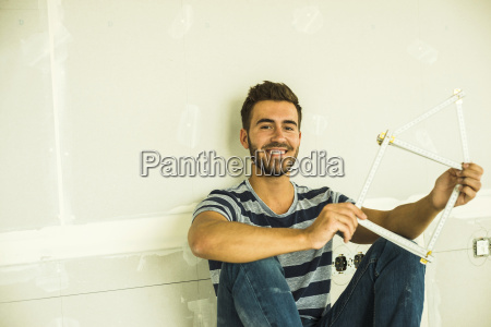 smiling young man sitting at blank