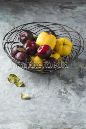 quinces and plums in basket