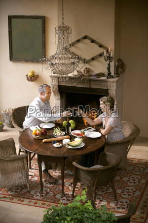 mature couple sitting at laid table