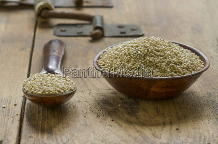 wooden bowl and spoon of quinoa