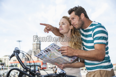 netherlands amsterdam couple with map looking