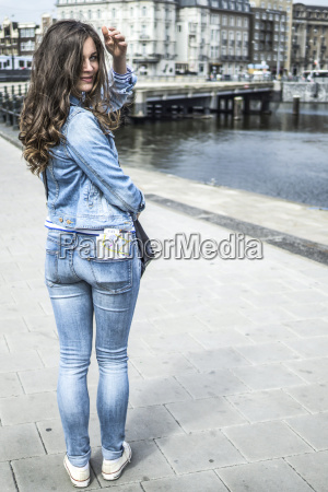 netherlands amsterdam female tourist with city
