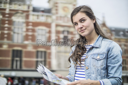 netherlands amsterdam woman with city map