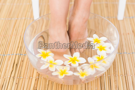 woman washing her feet in a