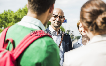 businesspeople talking outdoors