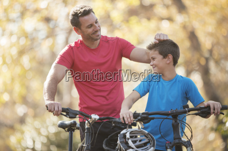 affectionate father and son with mountain