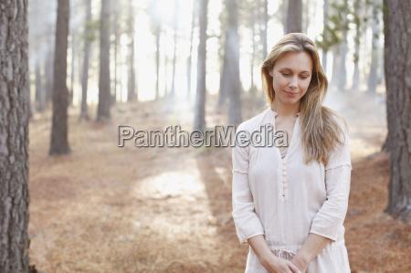 portrait of serene woman in sunny