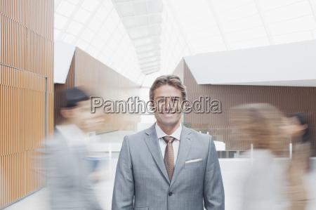 portrait of confident businessman with co