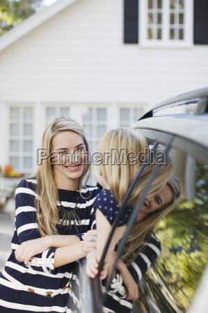mother talking to daughter in car