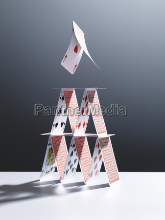 cards jumping above house of cards