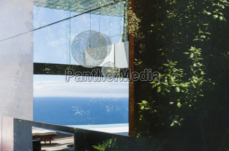 reflection on window overlooking ocean