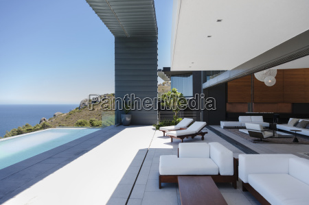 lounge chairs and infinity pool on