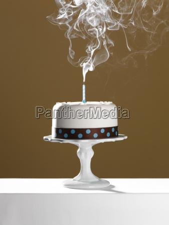 extinguished birthday candle on birthday cake