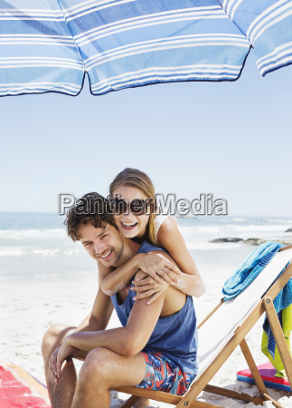 portrait of happy couple hugging at