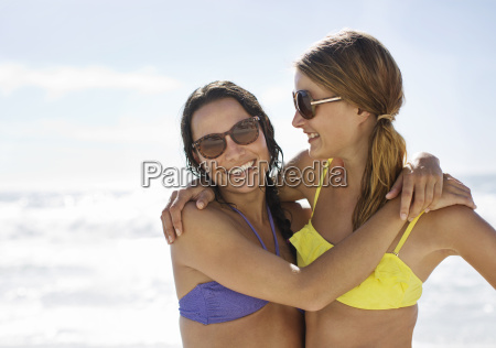 portrait of happy friends in bikinis