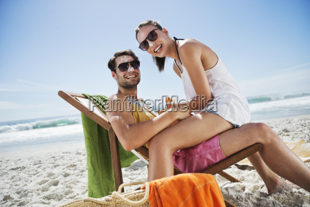 portrait of smiling couple with sunscreen