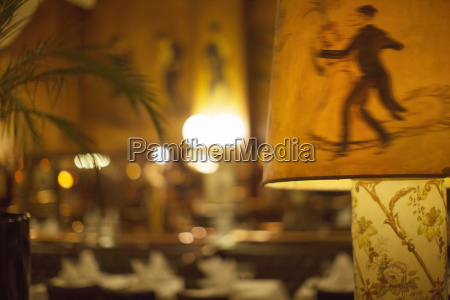 illustrated dancers on lampshade in restaurant