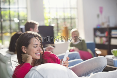 smiling woman using cell phone on