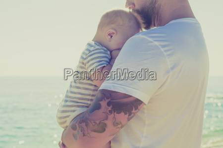 close up of father holding baby