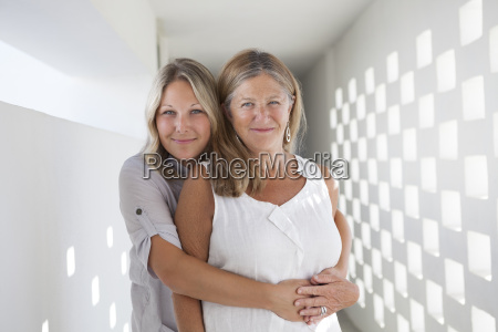 portrait of mother and daughter hugging
