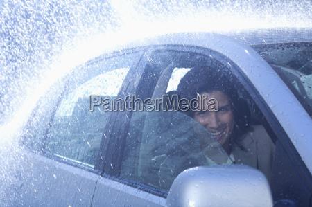 portrait of smiling businesswoman inside car