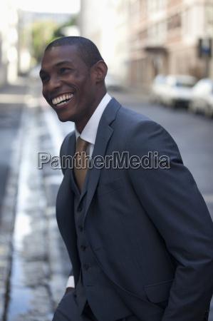 happy businessman walking in street