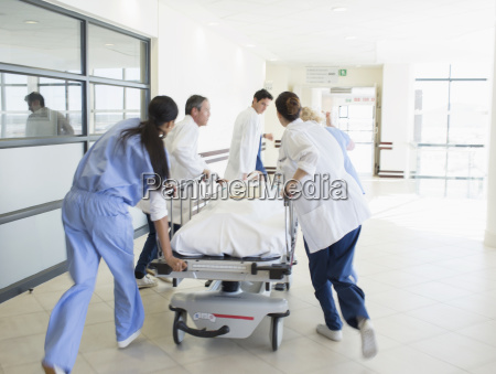 doctors rushing patient on stretcher down