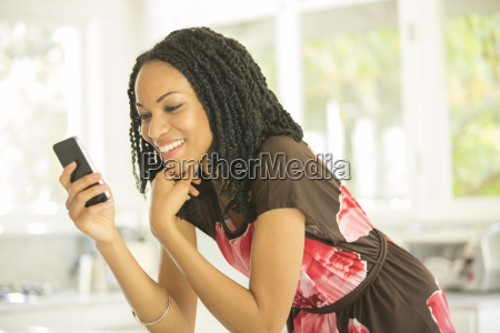 happy woman text messaging with cell