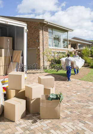 movers carrying sofa from moving van