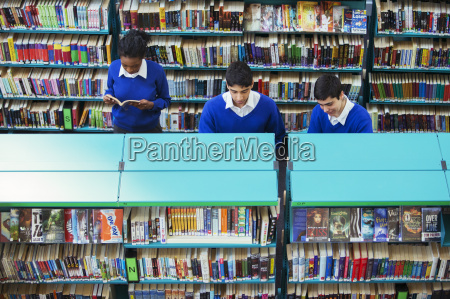 pupil learning in classroom using book
