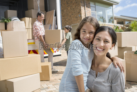 mother and daughter smiling by moving