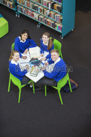 overhead view of four students doing