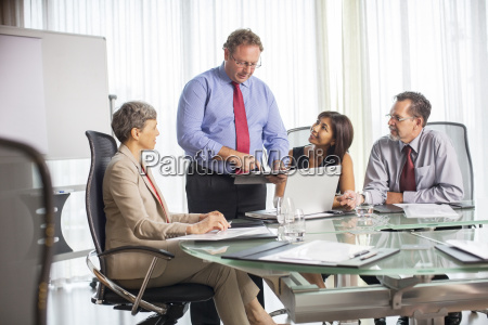 businessman giving presentation during business meeting