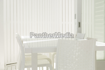 table and chairs in white dining