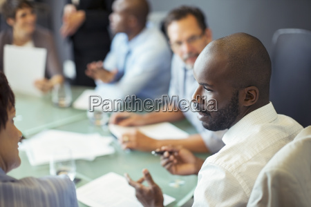businessman talking to colleague during business