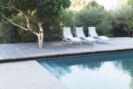 wooden deck and lounge chairs by