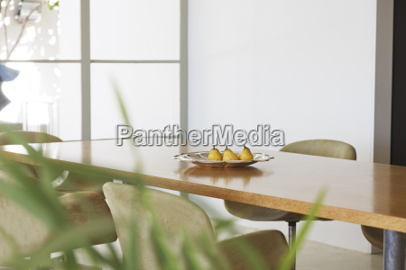 pears in dish on dining room