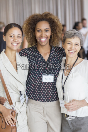 portrait of three women smiling to