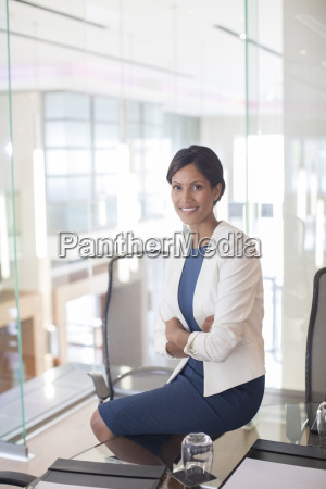 portrait of beautiful smiling businesswoman sitting