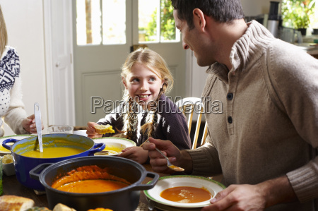 father and daughter eating together at