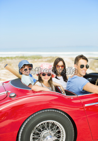portrait of smiling family in convertible