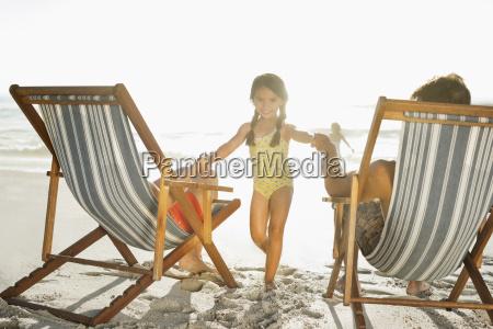 family relaxing on beach